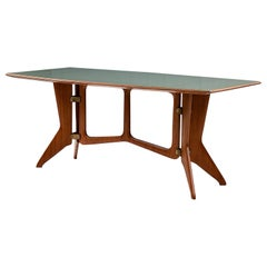 Sculptural Dining Table in Solid Teak and Brass and with a Glass Top Italy, 1950