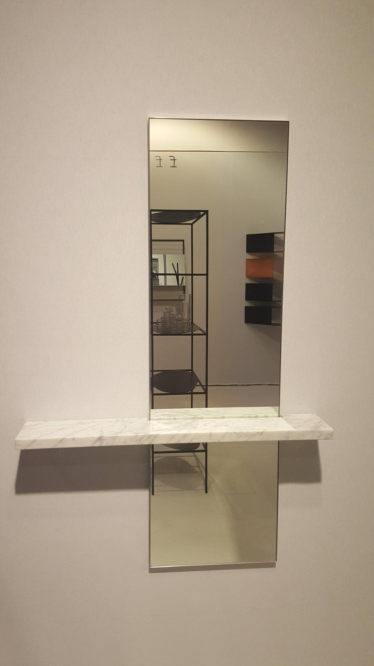 The minimal and contemporary wall-hung Edgewater mirror with shelf is perfect for an entryway, powder room or bedroom, this mirror with shelf is a rich balance between tension and harmony. The combination of materials work together in creating an