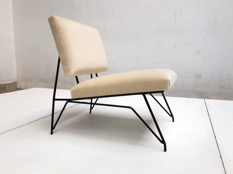 Exquisite and super rare sculptural form mohair lounge chair attributed to Ravegnati & Vicenzi for D'arbo, Italy circa 1951-1955. The beautifully crafted enameled steel rod frame resembles the Avant Garde sculptural designs of Mario Ravegnati &
