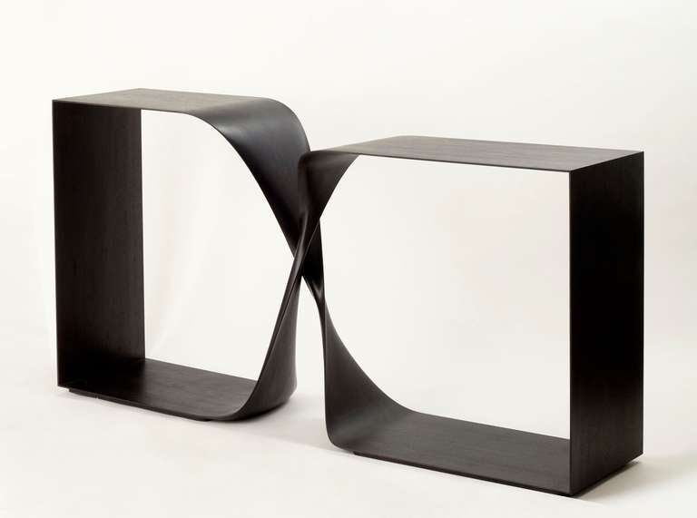 Contemporary freestanding console in hand carved ebonized mahogany by Carol Egan  Height of lower shelf: 34