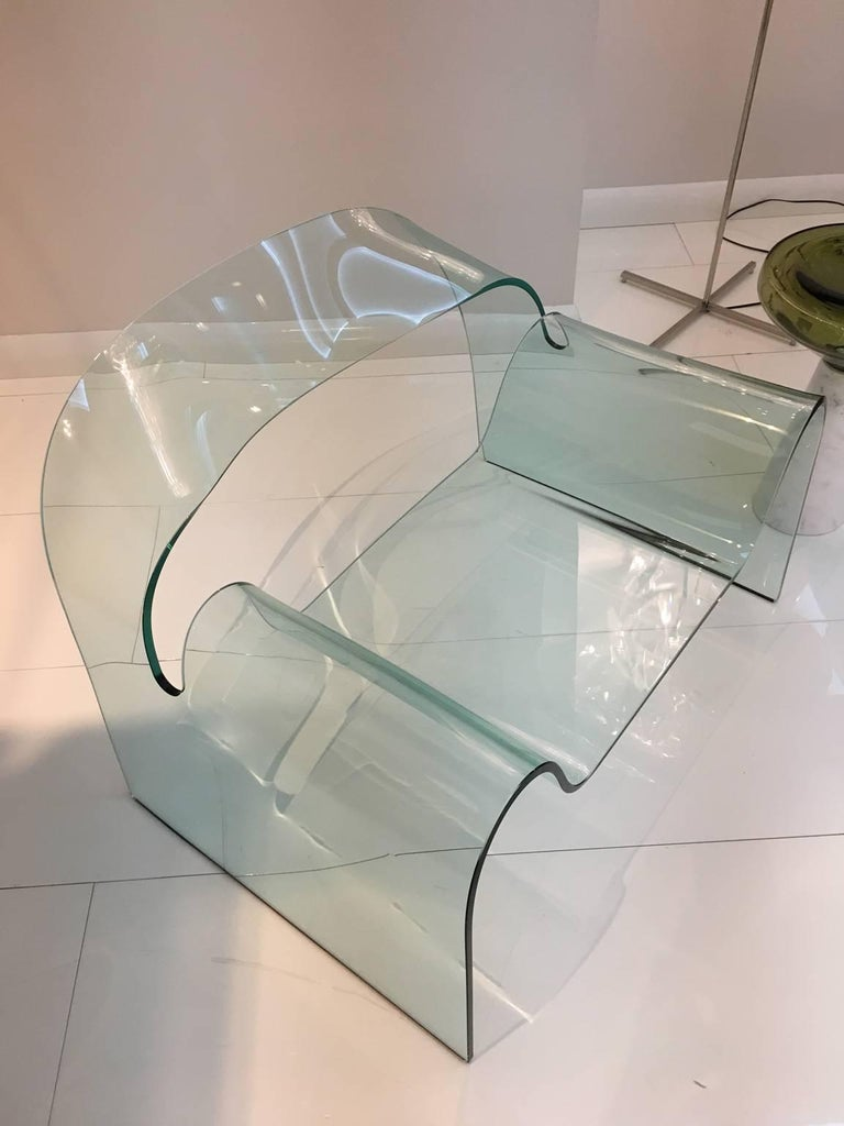 """Ghost, the glass armchair, was born, shaped by the technical and aesthetic skill of Vittorio Livi, debuting at the Salone del Mobile in Milan in 1987, where it immediately received an award in a competition by the magazine, """"Interni"""", which invited"""