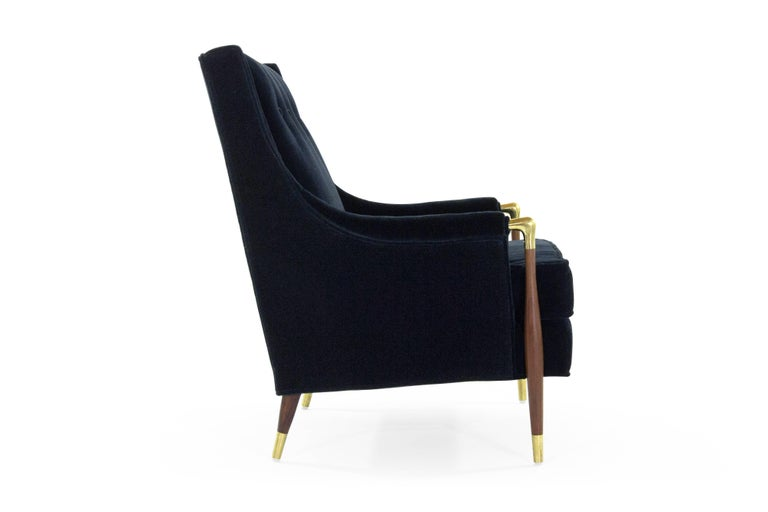 Large-scale highback lounge chair in the style of Gio Ponti. Walnut fully restored, newly upholstered in deep blue mohair by Donghia. Brass has been hand polished but retains a very nice patina.