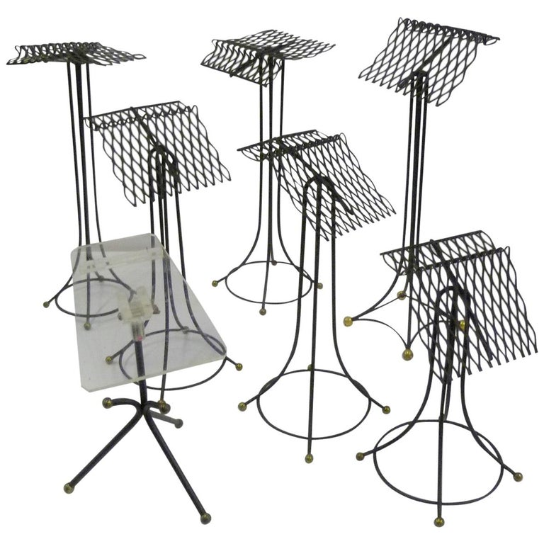 Sculptural Group of 7 Modern Black Wire Store Display Stands, 1930s-1940s For Sale