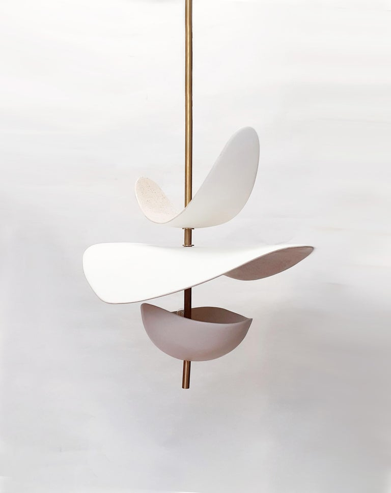 Sculptural ceramic suspension. Poetic and organic design handmade by Elsa Foulon Studio in her Parisian workshop. Enameled ceramic, brass structure and cotton electric wire. This suspension can be installed as you wish. Whatever height you prefer