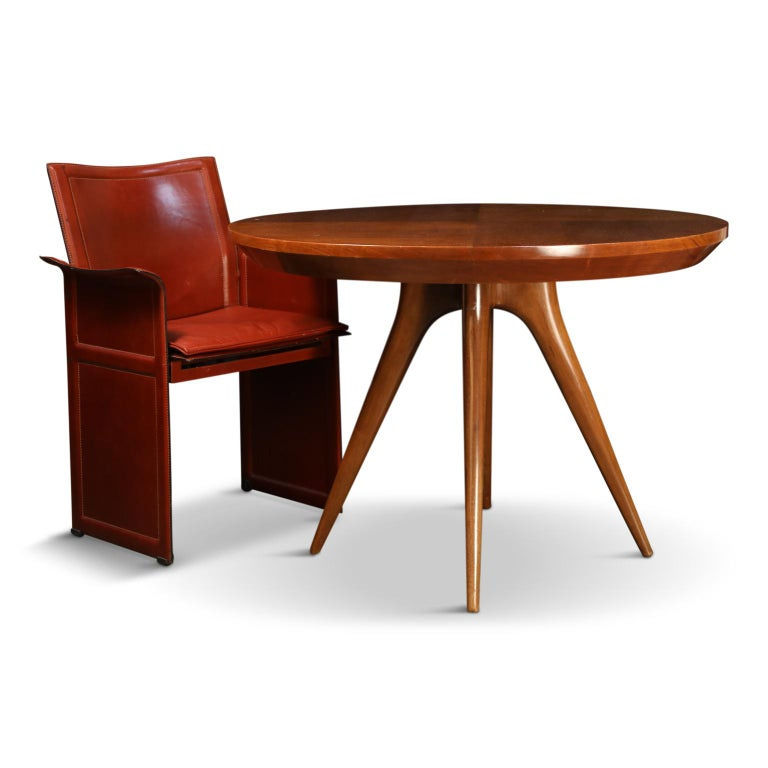 Reminiscent of his earlier work with Kagan-Dreyfuss, this gorgeous Vladimir Kagan sculpted leg dining table (or also an amazing choice as a breakfast, center, or game table) was custom produced for a family friend of his in 1998. Sharing similarity