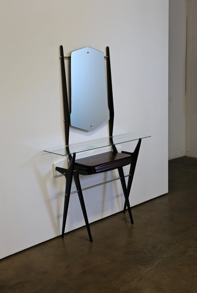 Sculptural Italian console with mirror, circa 1955. This piece has been professionally restored.
