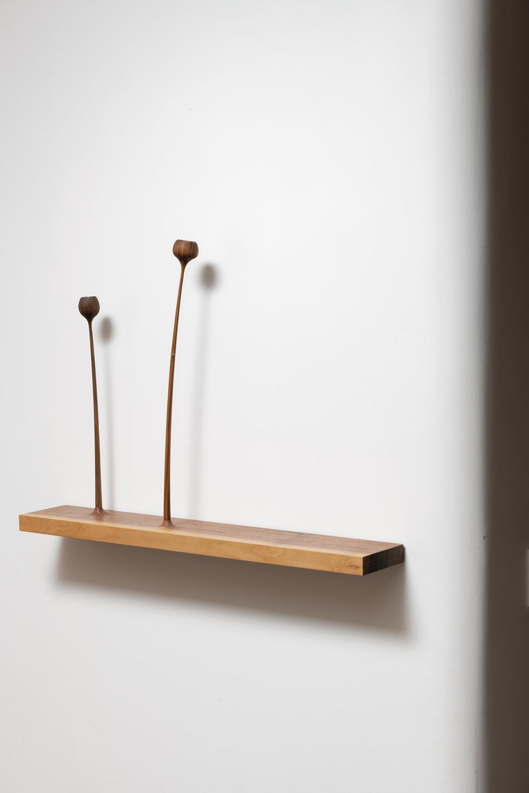 KUKKII (blooms) is a unique collection of slender-stemmed, wooden flowers and plants which, variously grouped, capture the moment of calm and freedom sometimes experienced in nature. The sculptural groups may be positioned on windowsill, or wall