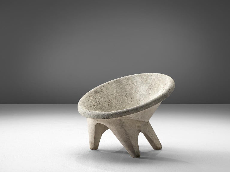Outdoor chair, concrete, Europe, 1970s.  This characteristic lounge chair is completely made of concrete. This makes it ideal for outdoor use, for in a garden of patio. The chairs feature a tilted round shell that functions as the seat. The bulky