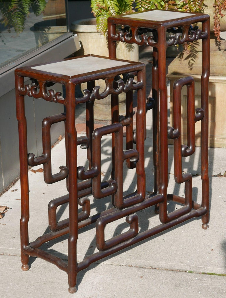 Sculptural rosewood Chinese republic era double pedestal or plant stand with marble tops. Featuring rosewood base with mortise and tenon construction. It's pretty amazing the actual construction of the piece. taller pedestal measures 12
