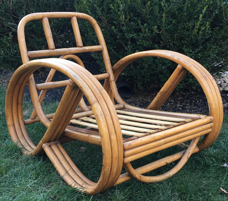 Sculptural Mid-Century Modern four-strand rattan 3/4 pretzel club lounge chair in original vintage condition with beautiful patina to rattan wood frame. Includes brand new 2 piece thick cushion set in neutral khaki tone UV and water resistant