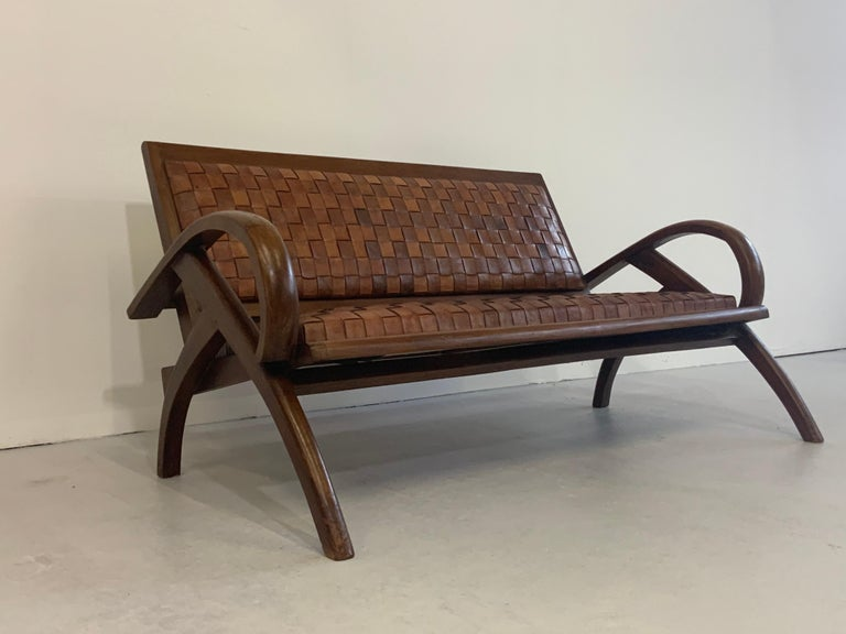 This captivatingly beautiful & very rare bench, settee ( 2-seat ) is a classical Scandinavian/ Danish Modern design beauty from 1950s-1960s.   Special features are the thick webbed - marvellous patinated - leather stripes in cognac brown and the