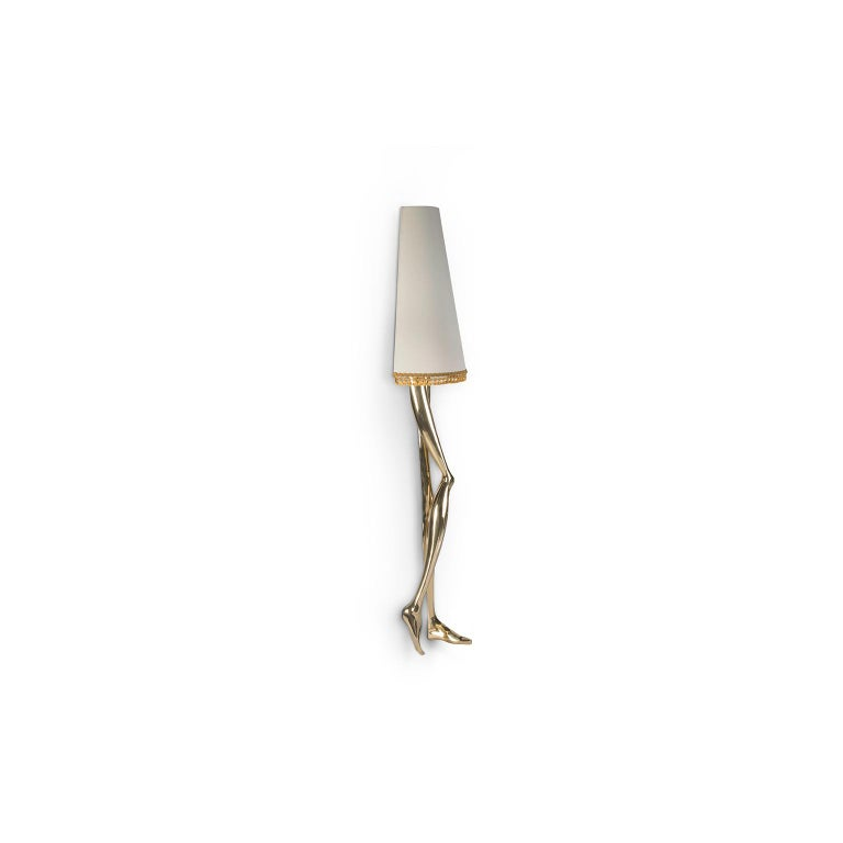 """1. Product description:  The """"Monroe"""" wall lamp is made of brushed brass cast with a lampshade adorned by a gold tassel fringe complementing the set. After smelting, a process known for thousands of years widely used in brass and bronze sculptures"""