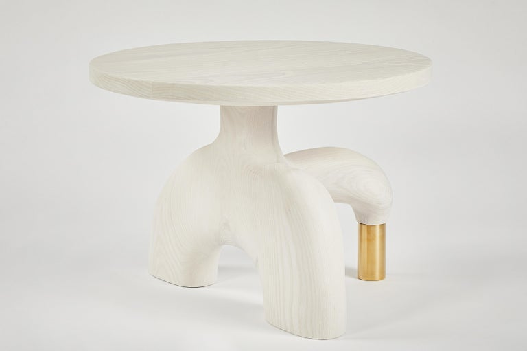 Sculptural organic hand carved, bleached ash side table. Made in the USA by Casey McCafferty.   Available finishes: Oiled black walnut, oiled white oak, bleached white oak, charred ash, oxidized maple  Customization is available. Charges may