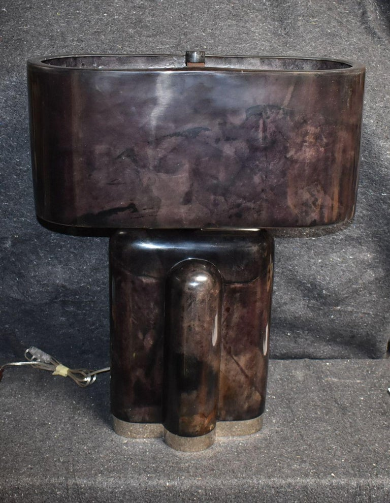 Tall table lamp cover goatskin with chrome base and parchment molded shade. (Single socket). Parchment is in varying shades of dark and light aubergine color. (High gloss polyester resin filled finish).  Additional dimensions of lamp without