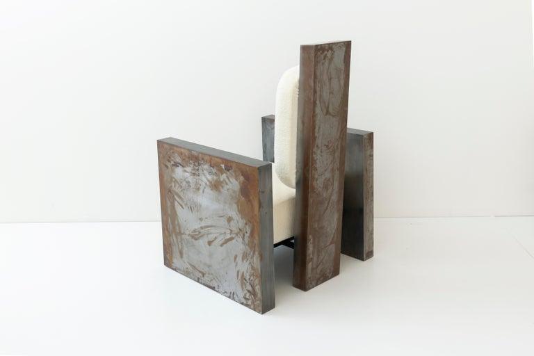 Sculptural patinated metal armchair by Rooms Dimensions: L 82 x W 73 x H 116 cm Materials: L 82 x W 73 x H 116