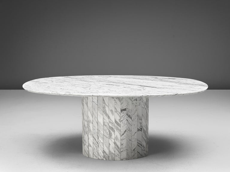 Oval dining table, white marble, Germany, 1970s  This archetypical pedestal table is a skillful example of Postmodern design. The table is executed in white marble with grey veins. The oval table features no joints or clamps and is architectural