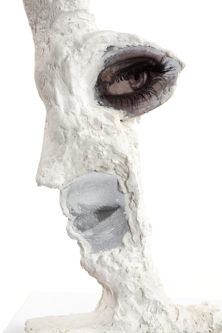 This is a new work by Mattia Biagi Sculptural plaster figure, plaster+ paper, and image collage on wood.