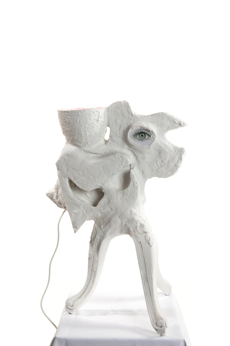This is a new work by Mattia Biagi Sculptural plaster lamp created by a metal structure, plaster+ paper, and image collage on wood.
