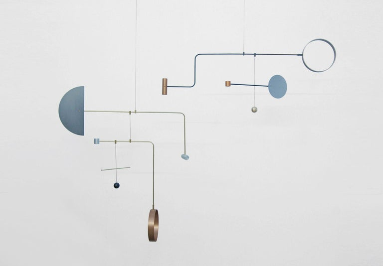 Point-Counterpoint is a series of large scale hanging sculptures exploring materials, shape, balance, and movement in space.  Crafted with custom machined fittings by L&G in their Brooklyn studio.  Contact for availability and options. Custom