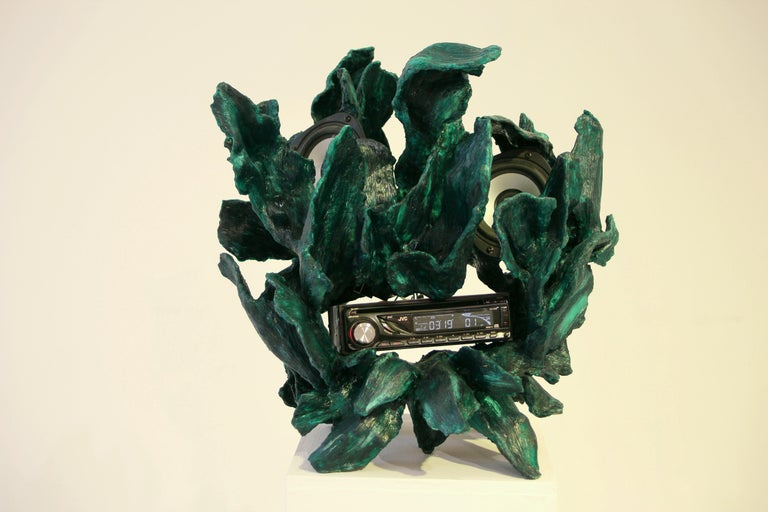 This is sculpture which is same time cd-player and radio. Its made of handcrafted fiberglass by designer Teemu Salonen. It is made in 2018 in Finland. This contemporary design object is full of details and it is very rough on purpose. Electricity