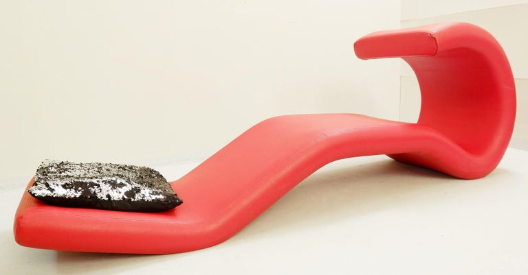 Sculptural red lounge chair.