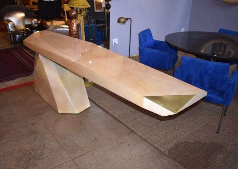 A fantastic sculptural cover with goatskin and brass detail top console table. Base is painted. (Top console finish with High gloss polyester resin filled).