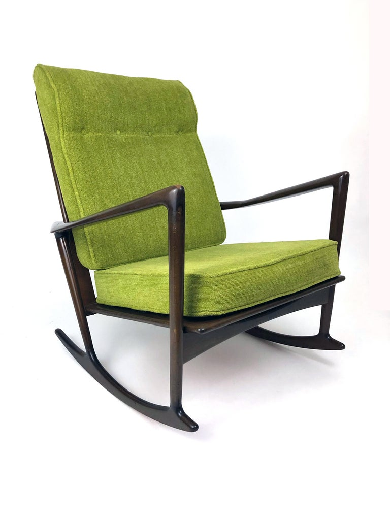 A dark walnut sculptural rocking chair designed by Ib Kofod-Larsen in 1962 for Christian Linnebergs Møbelfabrik. Imported to the U.S. by Selig.