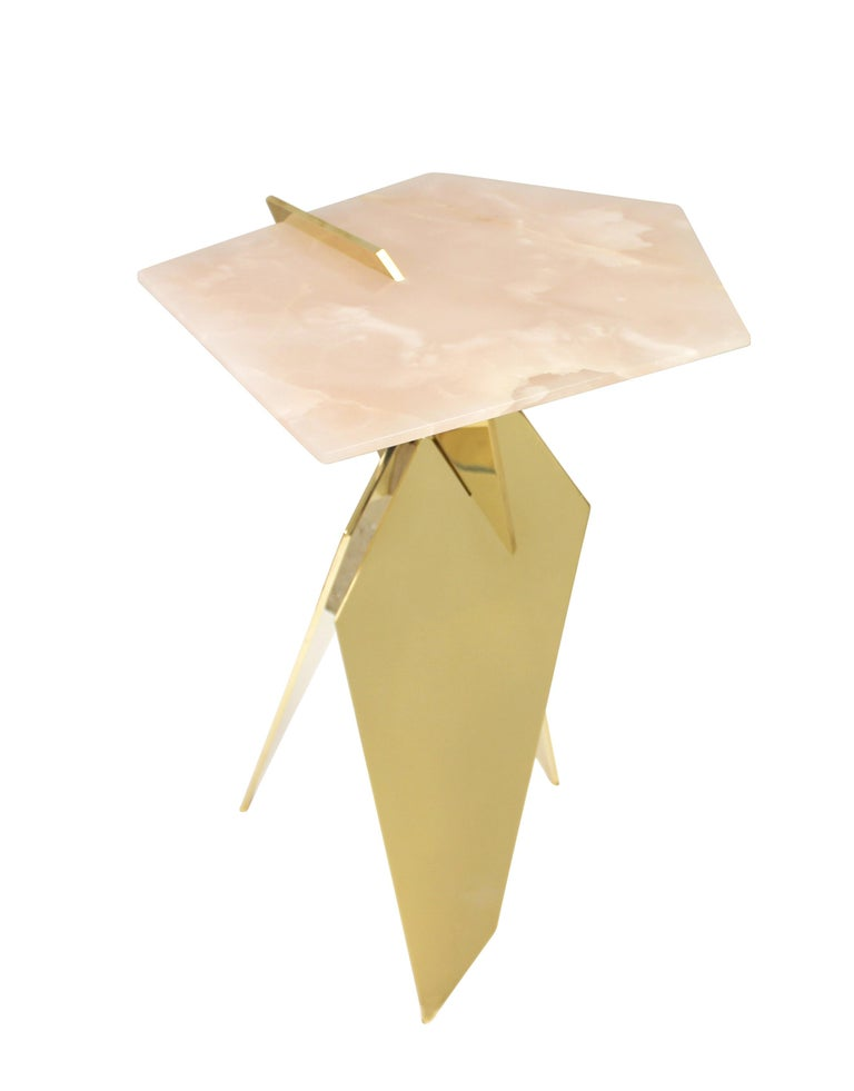 Sculptural side table made of hand polished solid bronze plates topped with pink onyx stone. Available in custom sizes, materials, and finishes.