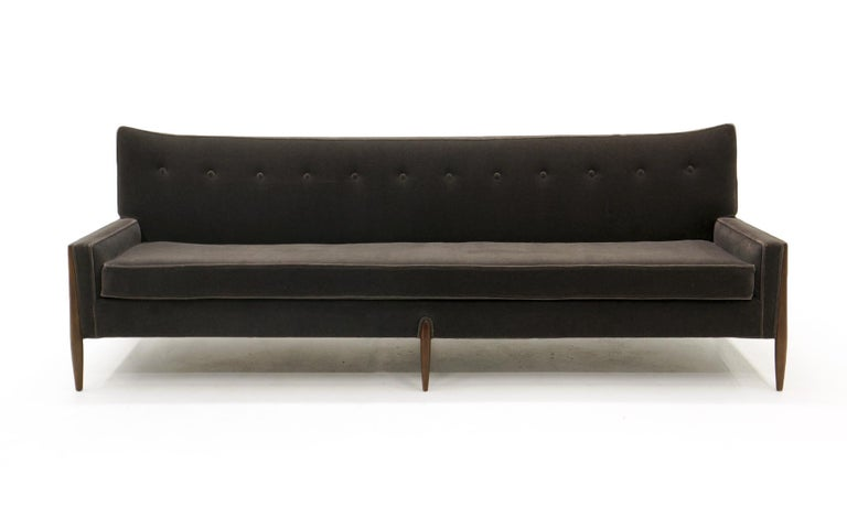 Sculptural sofa by Jules Heumann for Metropolitan. Expertly restored and reupholstered in a beautiful charcoal grey mohair fabric. The legs are reminiscent of designs by Vladimir Kagan. This striking design is also very comfortable.