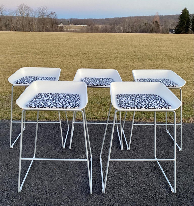 """Sculpturalmodern scoop bar stools with newly upholstered cushions using Diane Von Furstenberg white and black leopard """"Spotted Cat"""" print fabric. The DVF abstract fabric gives these geometric cubist style stools an edgy high fashion touch.   Each"""
