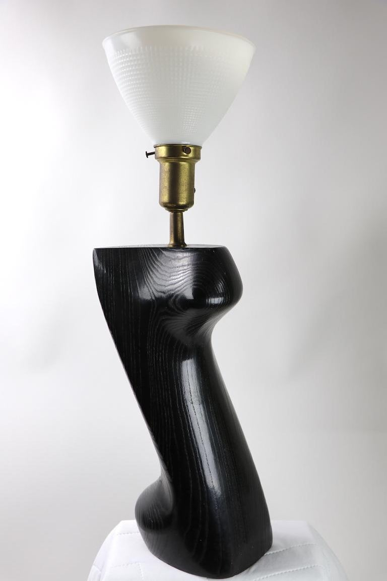 Stunning sculptural table lamp by Heifetz in black cerused oak. Organic modern design by recognized master of the style, Yasha Heifetz. Height to top of wood body 18 inches x Total H 28 in. Clean, working condition ready to use.