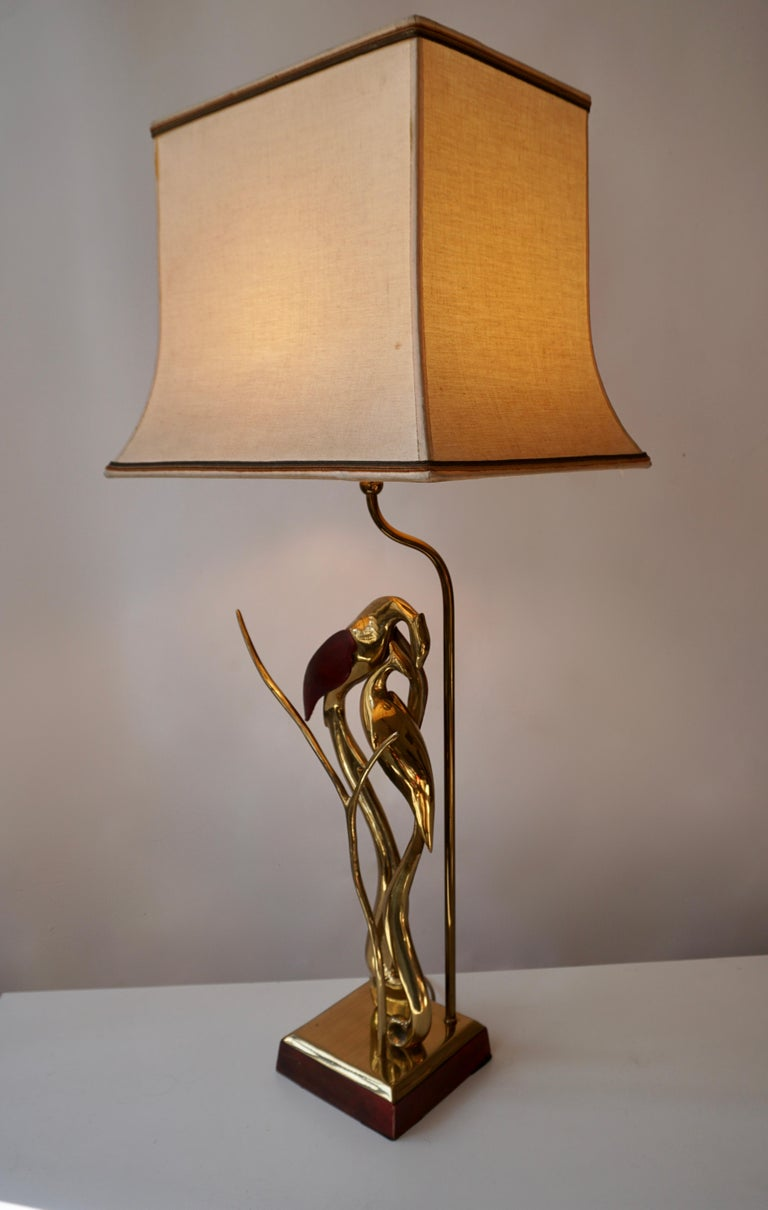 This beautiful sculptural bird lamp is made of brass with leather wings, circa 1970. Measures: Height 82 cm. Width 35 cm. Depth 28 cm.