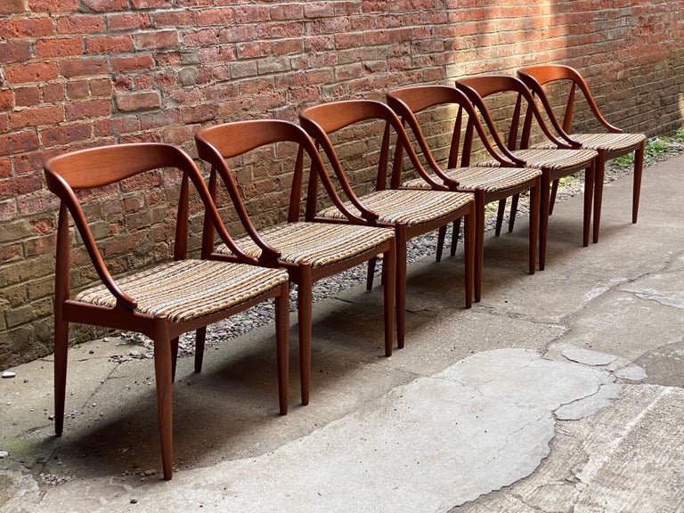 Set of six sculptural teak dining chairs by Johannes Andersen for Moreddi, Denmark. Beautiful solid teak frames with wonderful nubby wool fabric upholstered seats. A comfortable chair. Signed on seat bottoms. All are structurally sound and sturdy.