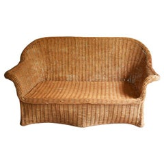 Sculptural Trompe L'Oeil Draped Wicker Bamboo Ghost Sofa after Michael Taylor