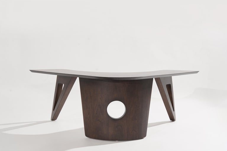 Walnut coffee table featuring a boomerang-shaped top, circa 1950-1959. Fully restored to its original espresso finish. Talk about a conversation piece!  Other designers from this period include Adrian Pearsall, Vladimir Kagan, Hans Wegner, Gio