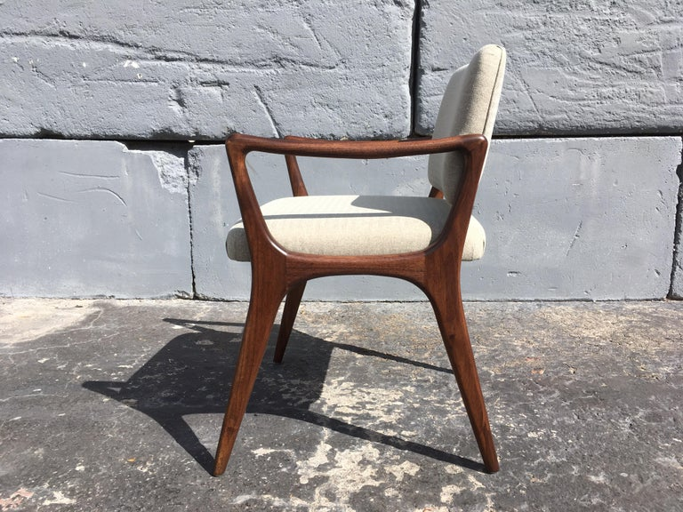 """Set of six sculptural dining chairs in the style of Gio Ponti. Walnut frames with fabric backs and seats. Arm height is 25.25"""" More chairs available."""