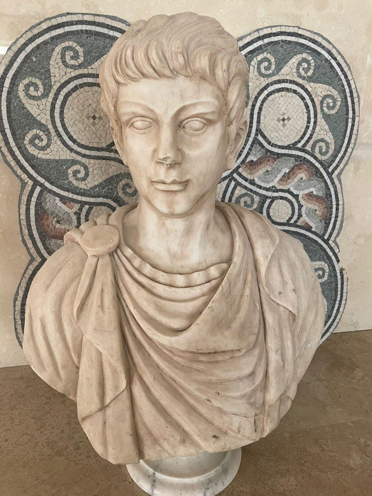 The sculpture realized by a Roman sculptor as from the Roman academy tradition, is carved with white marble. The sculpture represents the face of a young Julius Caesar, Julius Caesar formally known as Caesar was a Roman general and statesman who