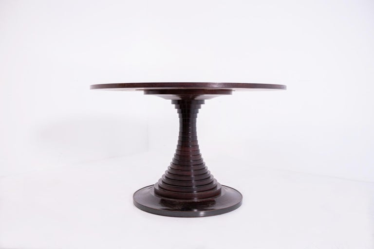 Rare sculpture center table model 180 designed by Carlo de Carli and produced by Luigi Sormani in 1963. The majestic sculpture center table was made with fine solid wood and has beautiful grains. The top of the Carlo de Carli table is circular in