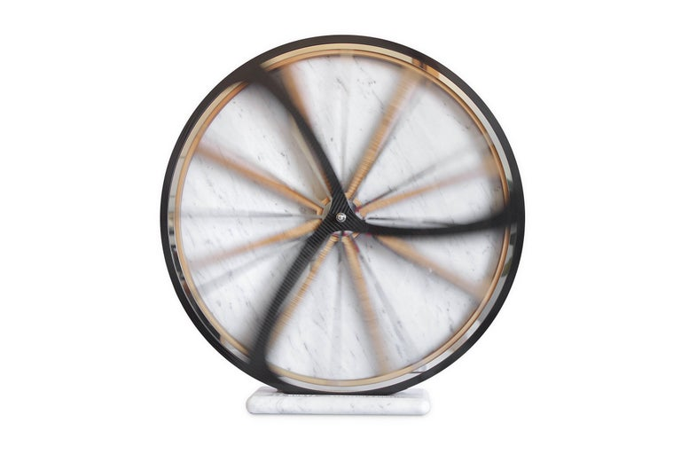 Sculpture dimension: Diameter 60cm. Materials used white marble from Carrara, oakwood, aluminium, carbon fibre.