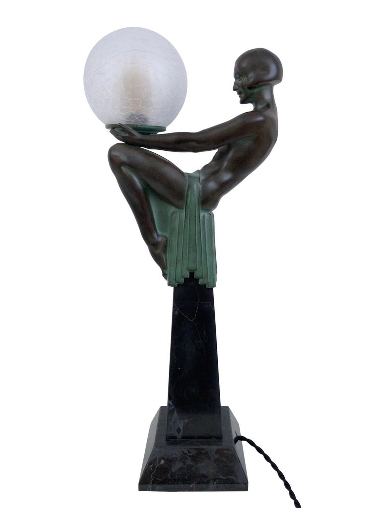 """""""Enigme""""  Original """"Max Le Verrier"""" Art Deco style, France   Beautiful sitting lady  Table lamp, cculpture made in """"Régule"""" (spelter)  Socle in black marble (could have a different marbleization than the picture)  Patinated - Handwork, patina"""