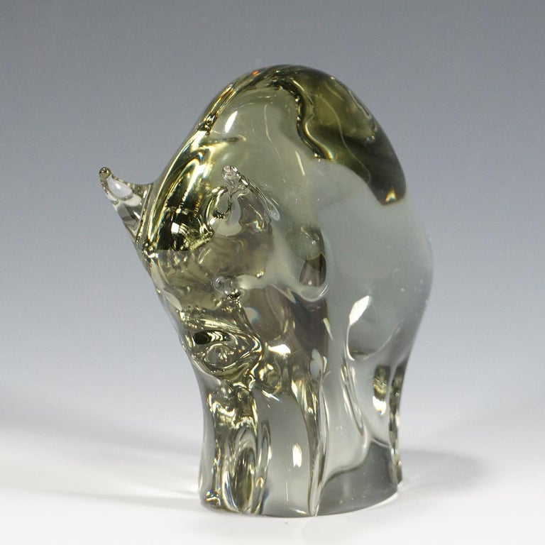 A great stylized sculpture of a bison in smoke grey glass. Handmade in the gral glass manufactory, Germany. Designed by Livio Seguso, circa 1970. Base with incised signature of the artist (LS).  Lit.: gralglas informationen 8, leavelet of the
