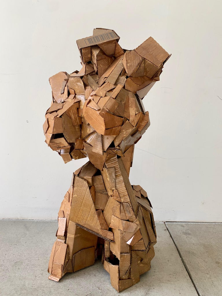 An original sculpture of a woman's form made of lacquered cardboard pieces - a wonderfully creative expression of the female form.