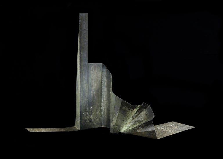 A massive, Mid-Century Modern, steel, abstract Expressionist, sculpture.  Striking sculpture displaying a sharp contrast between the fluid curling form and the rigid Industrial material presenting an active, changing, shifting form with momentum