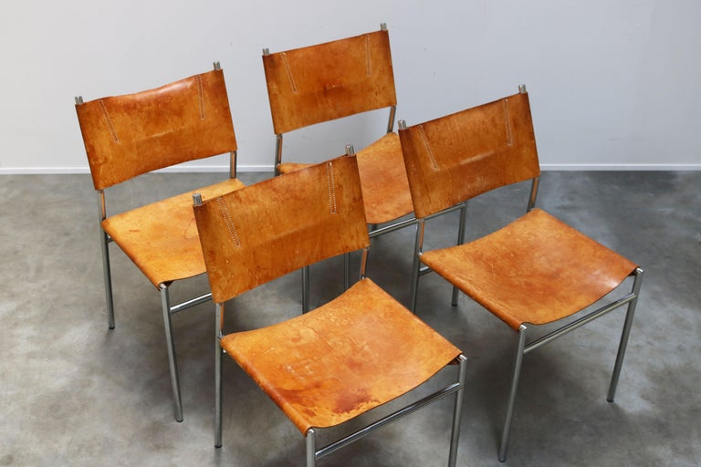 Magnificent pair of SZ01 minimalist chairs in Gocnac leather and chrome by Dutch industrial designer: Martin Visser for T' Spectrum in 1960. The minimalist tubular chrome frame in combination with the cognac leather upholstery was revolutionary for