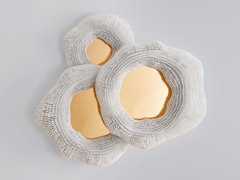 From simple beech rods patiently cut, sanded, arranged and lacquered, Pia Maria Raeder creates refined functional sculptures that evoke biomorphic forms. Each work in the collection 'Sea Anemones' is handmade. More than 180 hours of work and 11,000