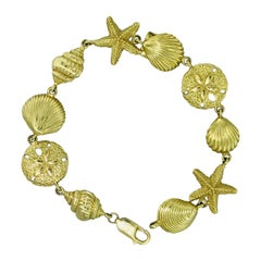 Sea Life Yellow Gold Bracelet with Large Shell, Starfish, Sea Dollars