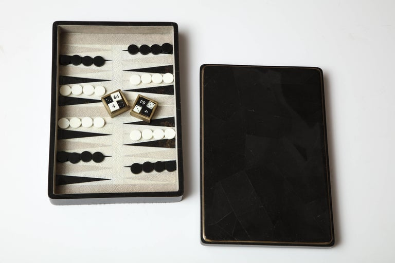 Decorative backgammon game designed in black sea shell and shagreen. Detail around the box is made of brass. Designed in France. We have one game in stock. This is a great gift.