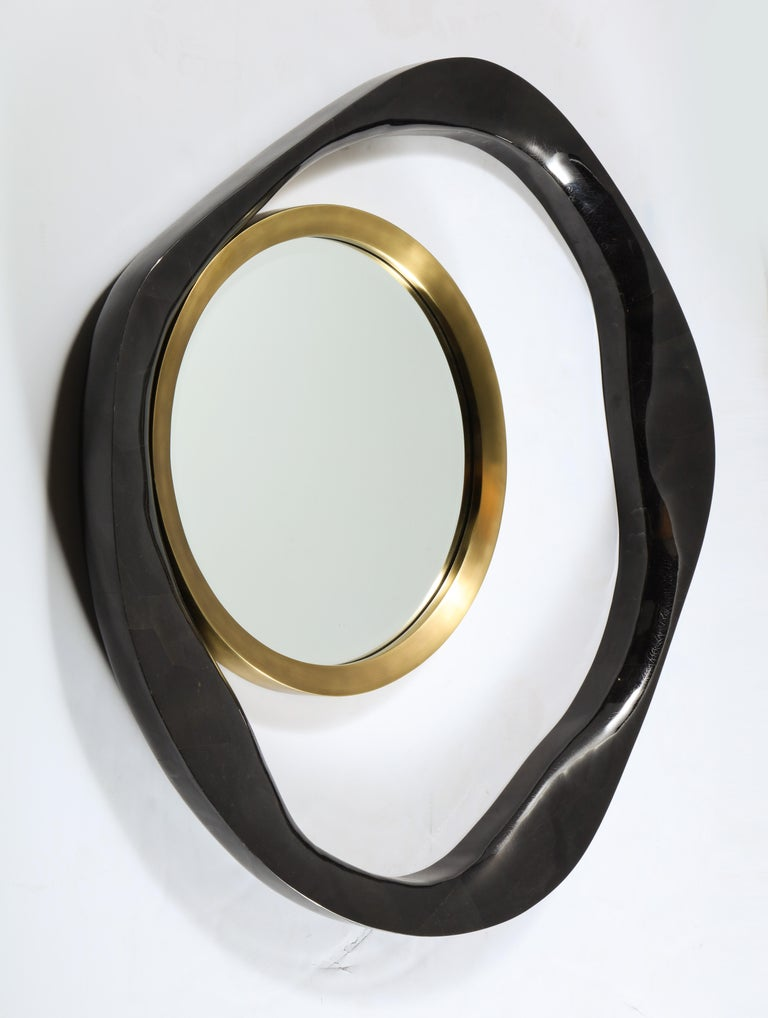 Decorative black organic shaped sea shell and brass mirror. You can hang it in three different ways. Designed in France. This is the large size. We have one in stock.