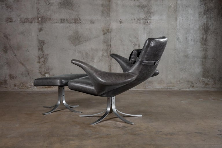 Seagull chair and ottoman in black leather.