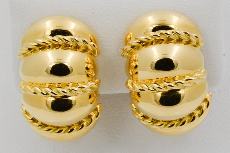 From Seaman Schepps, these 18k yellow gold Shrimp earrings have a rope design. Signed Seaman Schepps.